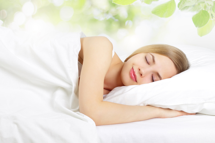 Sleeping Girl on the bed. on light background